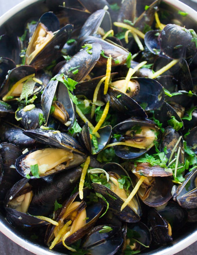 A close up showing how mussels open up during cooking