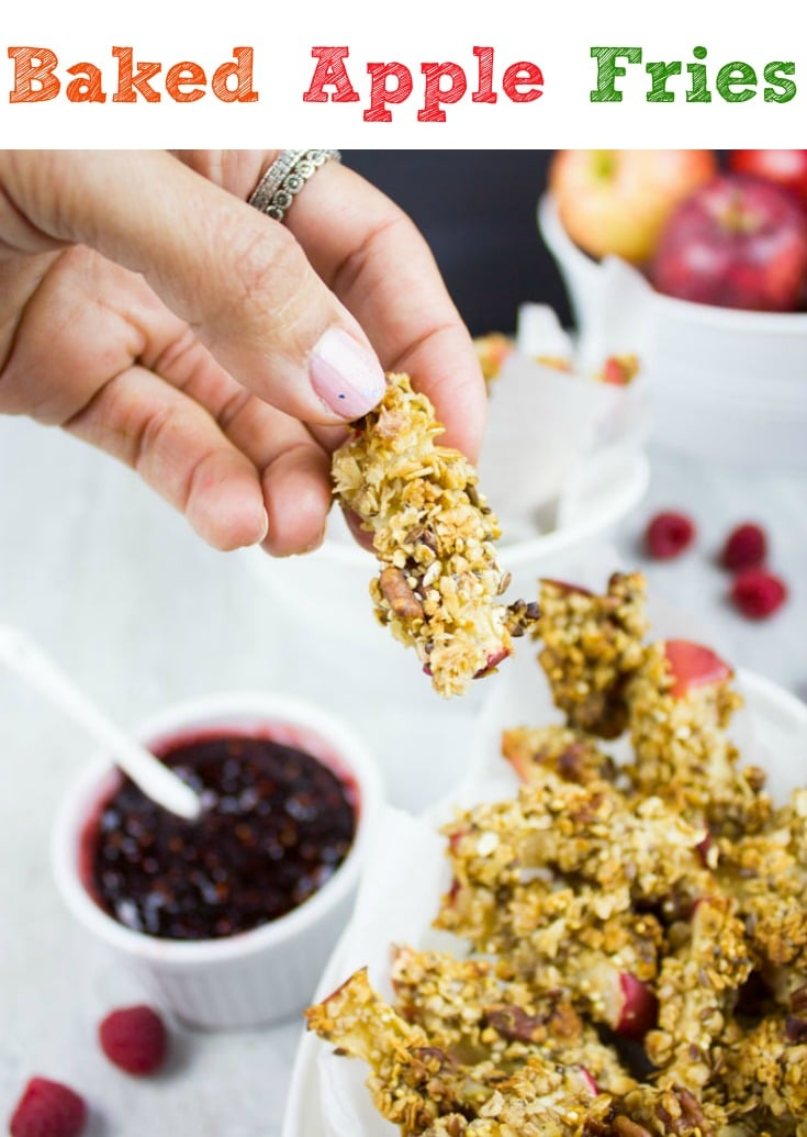 Baked Apple Fries with Raspberry Sauce ! These healthy granola-coated apple sticks are highly addictive. Every bite is a crunch of oats, seeds and nuts with a tender sweet baked apple inside. A healthy, fun snack your whole family will love! #snack, #easy, #healthy, #baked