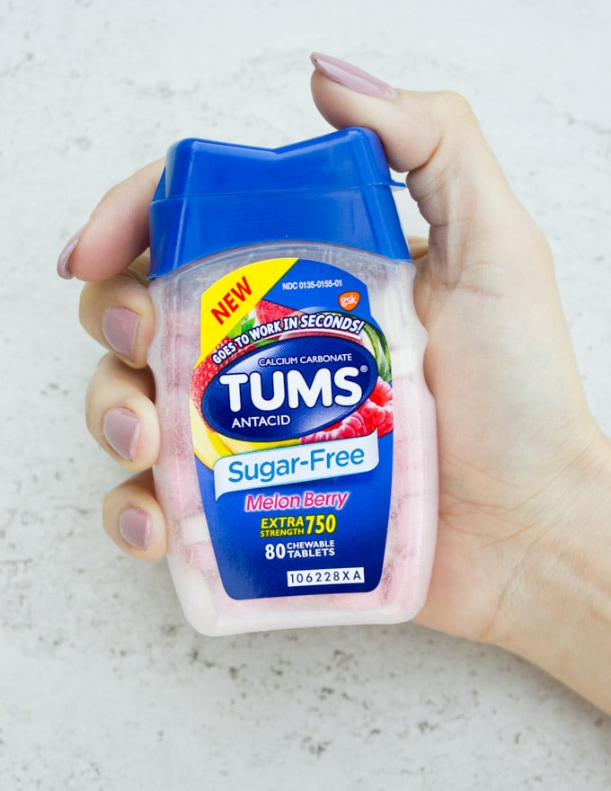 hand holding the TUMS bottle