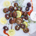 Ready grilled Buffalo mushrooms and saue, lemon slices on a paper