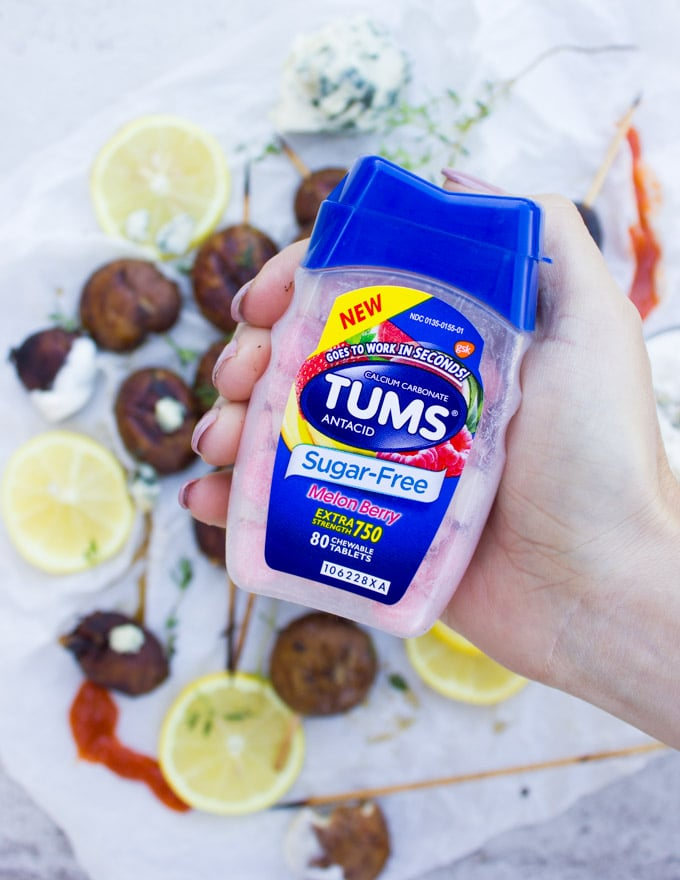 close up of a hand holding the TUMS bottle