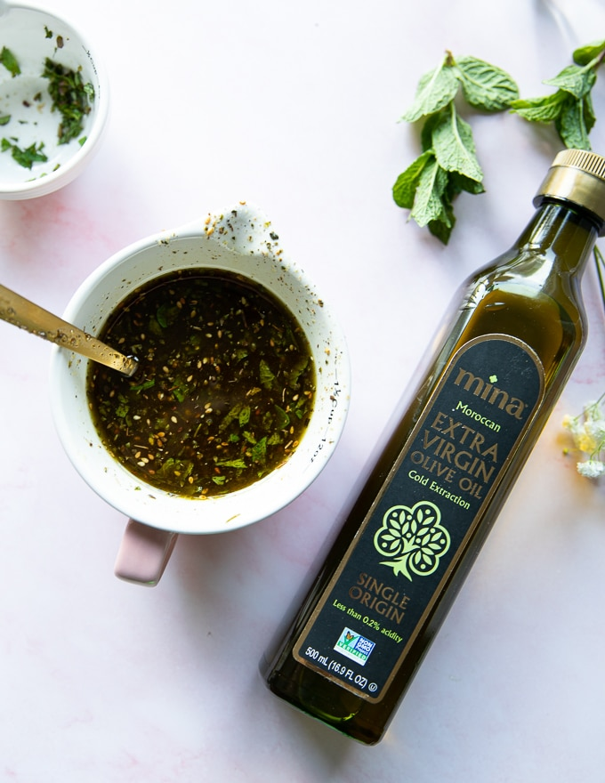 bottle of moroccan olive oil near a bowl of zaatar