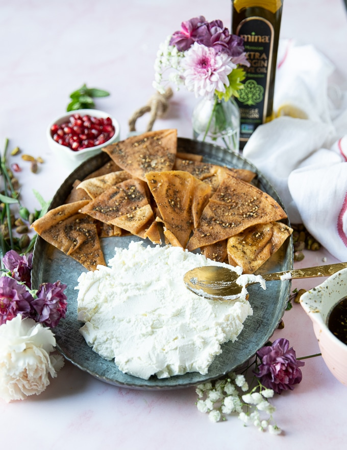 Finished labneh spread on a plate and ready for the topping