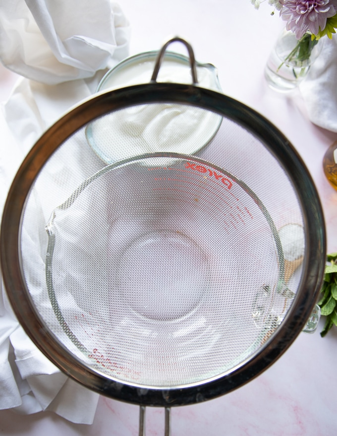 A sieve placed over a large bowl to help srain the yogurt to make labneh recipe