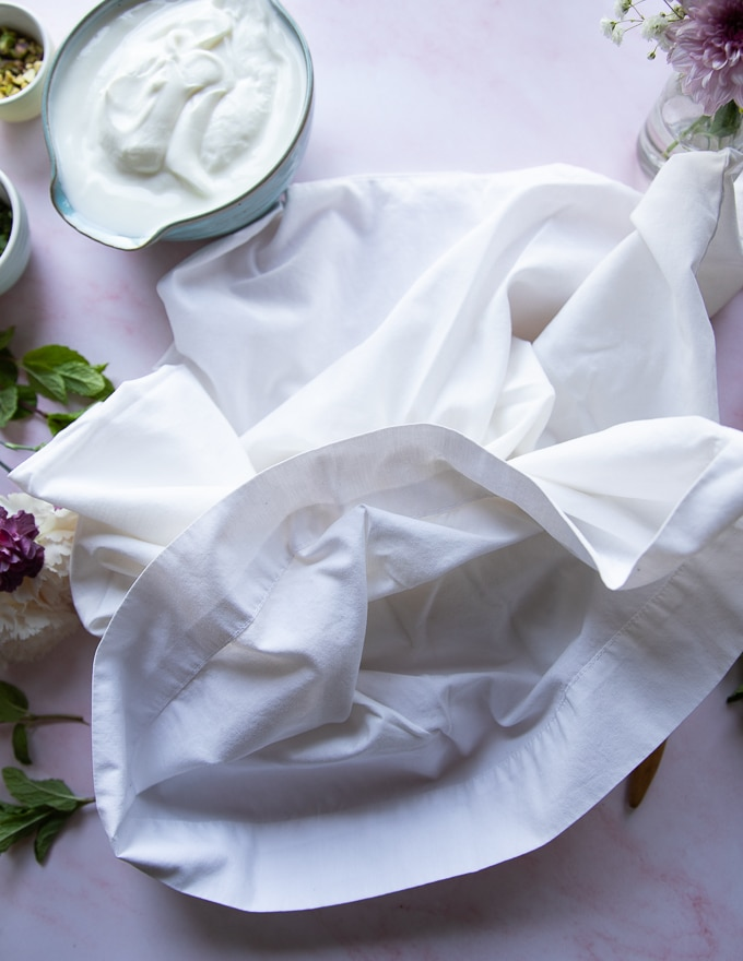 a pillowcase on a marble board which is the best way to make labneh!!