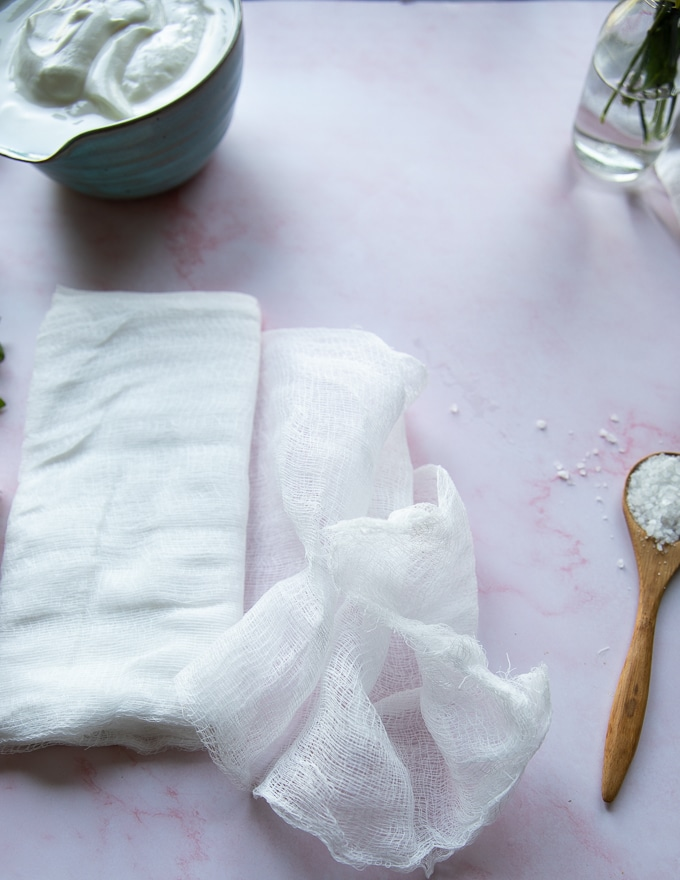 A cheese cloth on a marble board which is used to strain the yogurt and make labneh
