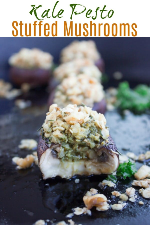 These Easy Stuffed Mushrooms with Kale Pesto and a Crunchy Walnut Topping are a healthy twist on a classic restaurant-style appetizer! A gluten-free, paleo and vegan diet-friendly finger food that you can enjoy without any guilt. #appetizers, #mushrooms, #paleo, #fingerfood, #party, #easy, #glutenfree, #stuffed, #baked