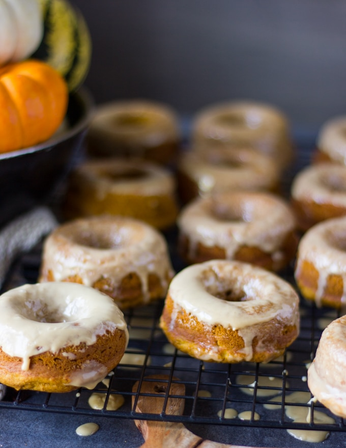 glazed pumpkin donuts over a cooling rack