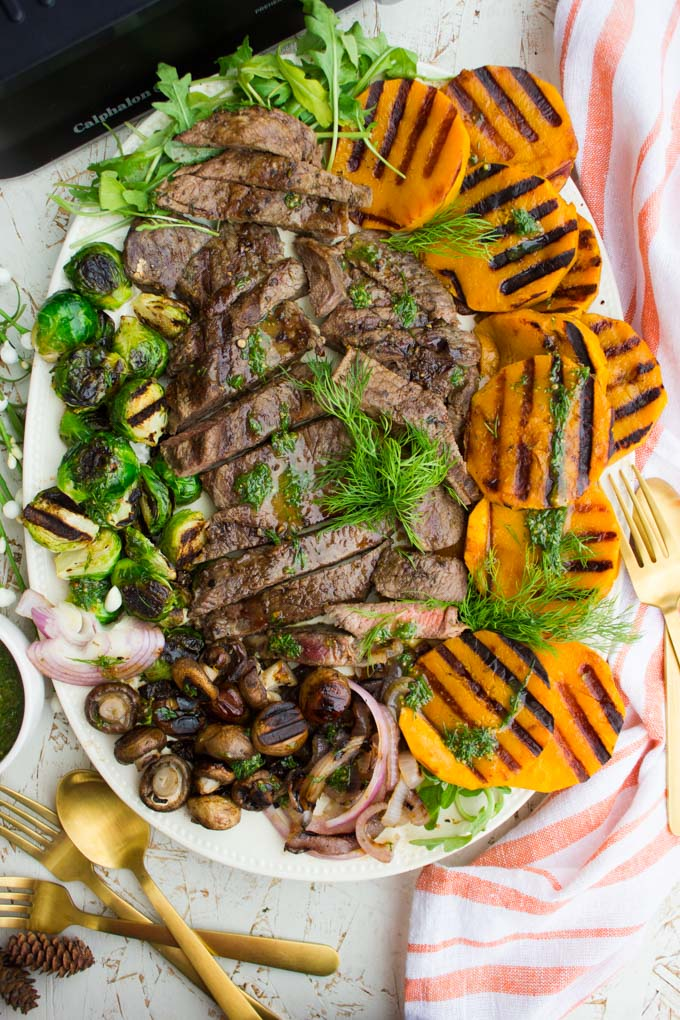 top view close up of the grilled steak platter with veggies