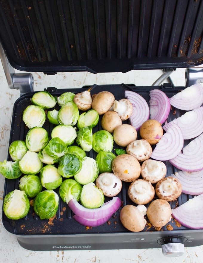 Veggies being placed on the grill