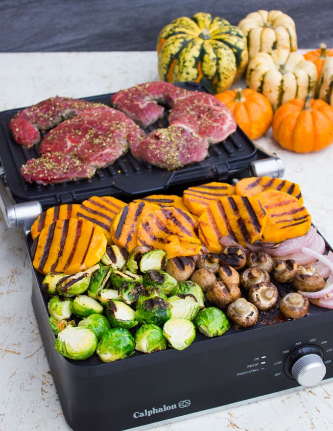 Steak on the grill with veggies