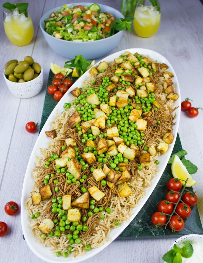 Green peas and roast potatoes topped over the vermicelli noodles for the lamb shoulder recipe