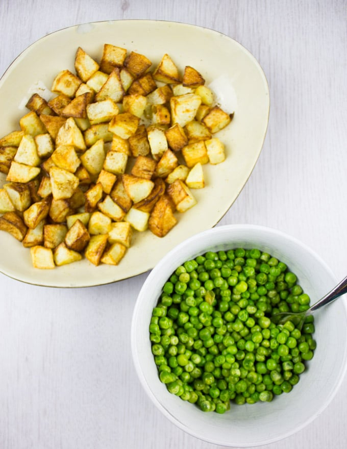 roasted cubed potatoes and cooked green peas