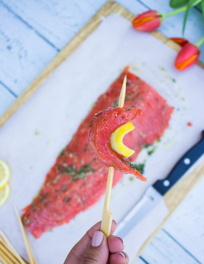 Fillet of salmon ready to be cut up and skewered with lemon