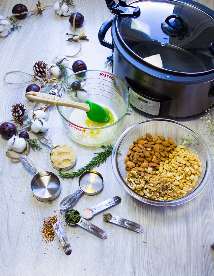 All the ingredients for the spiced nuts: honey, butter, spice, nuts and the crockpot