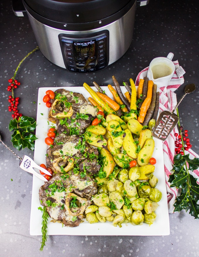 A huge platter of Osso Bucco and Veggies with the Corck-Pot at the back