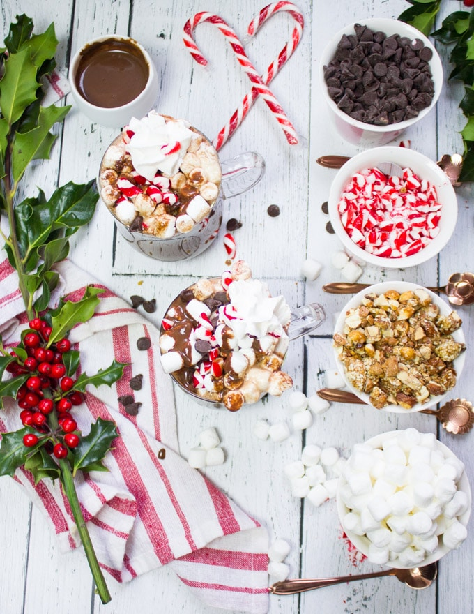 Top view of hot chocolate bar toppings and the perfect homemade hot chocolate cups