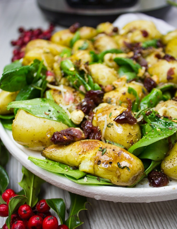 A close up of the potato salad with golden crust and spinach