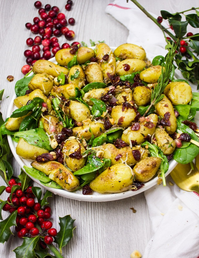 Big Plate of Potato salad with spinach and cranberries