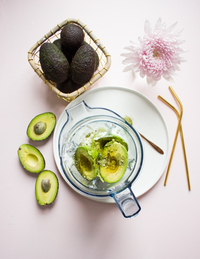 All the avocado smoothie recipe ingredients are placed in a blender