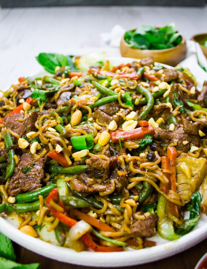 Details of the lamb stir fry in the stir noodles and stir veggies drenched in stir fry sauce
