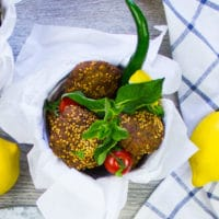 three falafels in a bucket with fresh mint