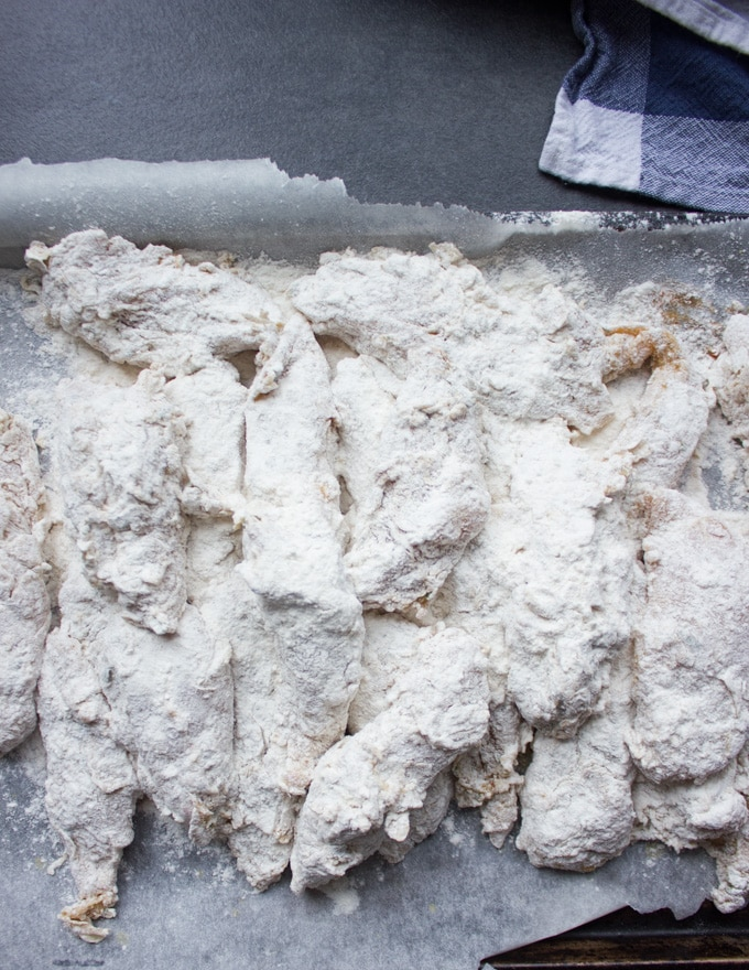 Chicken coated in flour and ready for frying