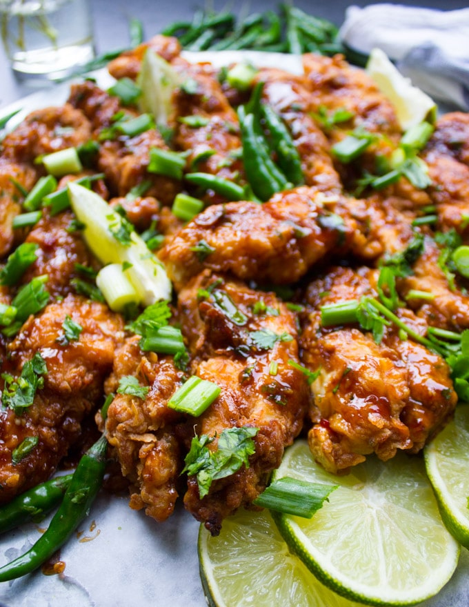 Korean Fried Chicken Strips with lime slices and cilnatro