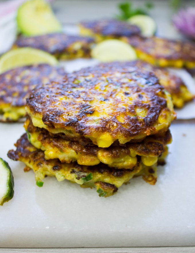Stack of three corn fritters out of the pan
