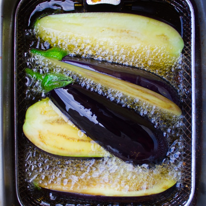 eggplants frying in hot oil