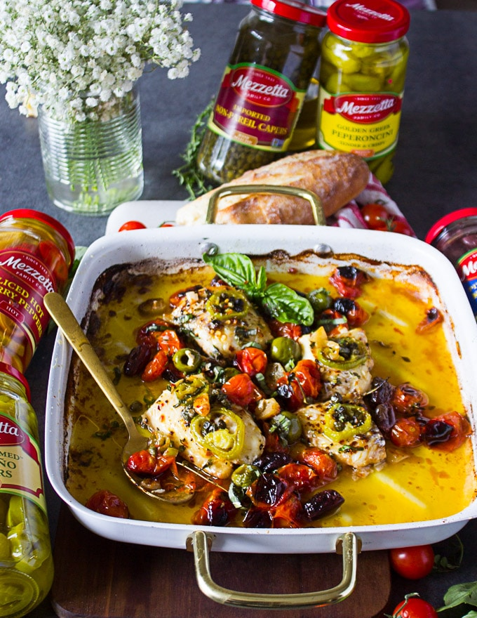The baked fish recipe ready and a spoon used to serve it