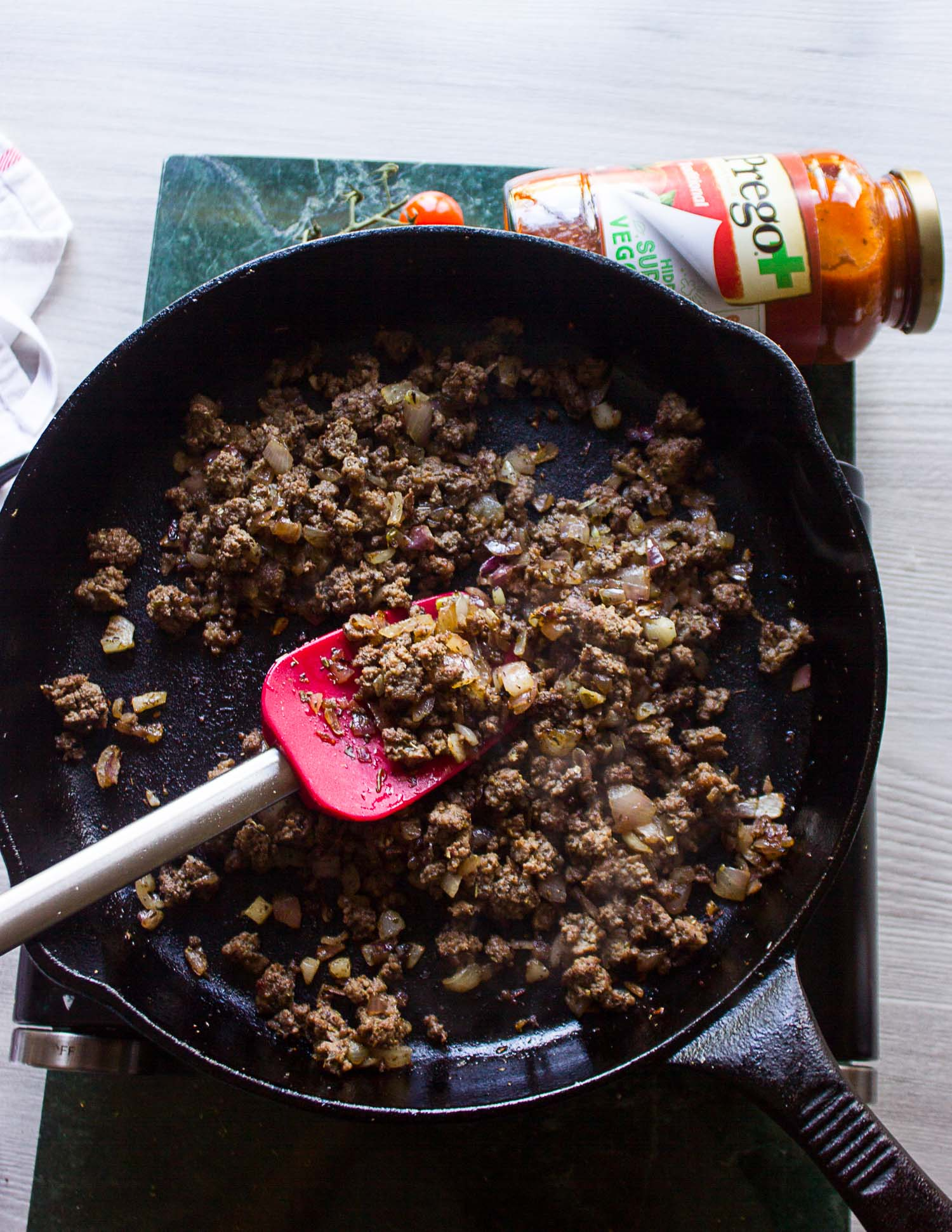 A mixture of ground beef cooked in a pan