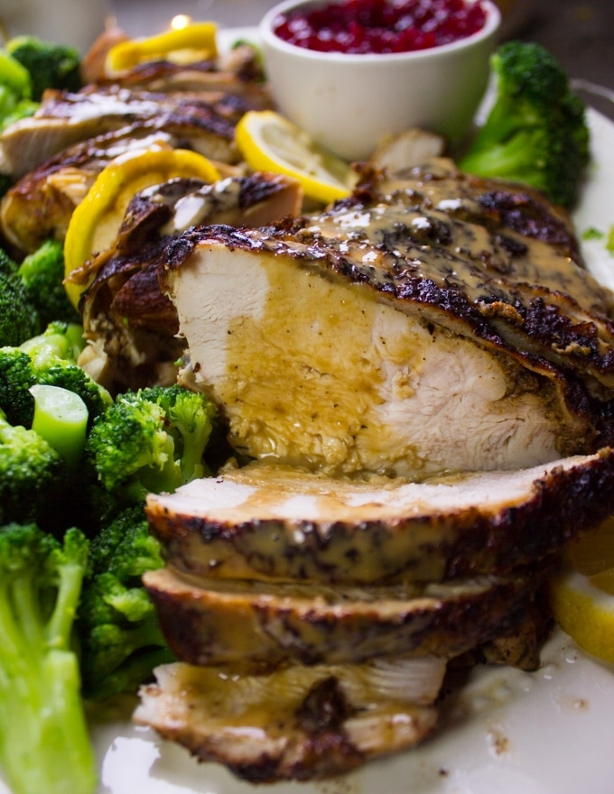 Close up of one slice of turkey breast recipe showing how juicy the turkey breast is!