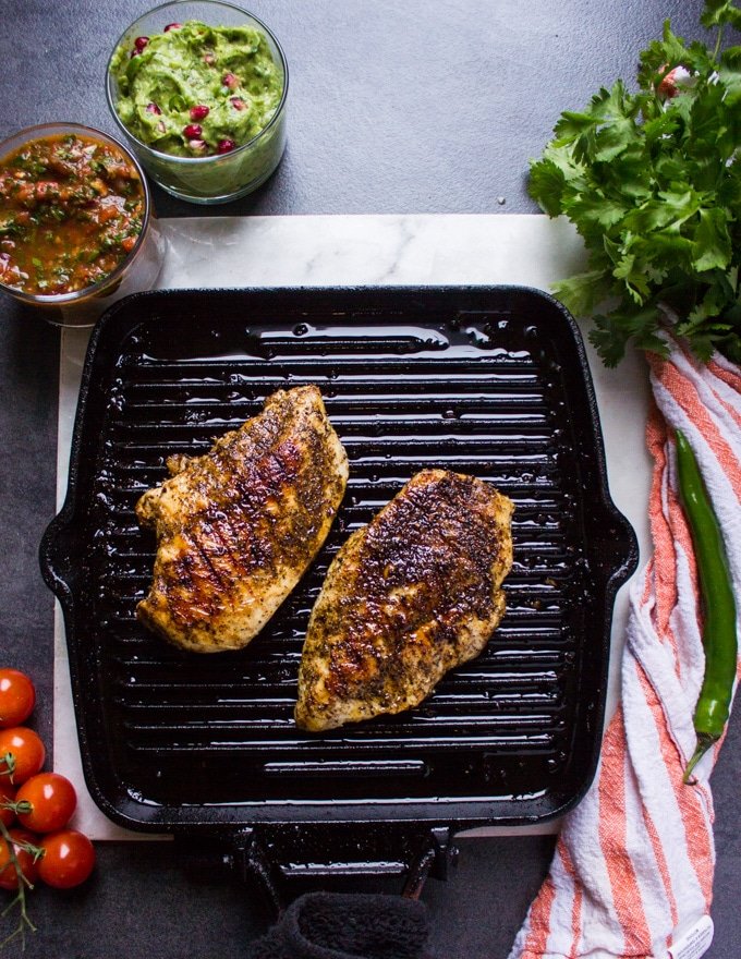 Chicken breasts grilled on a stove grill pan showing the grill marks