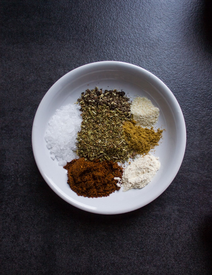 A bowl of the fajita spice including chilli powder, cumin, oregano, salt, pepper, garlic powder, onion powder