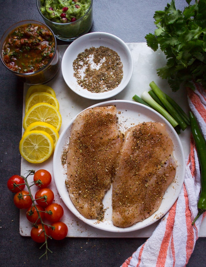 Fully seasoned chicken breasts on both sides liberally with the fajita spice