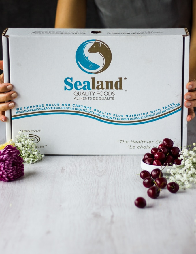 two hands holding a box of Sealand Foods delivery box