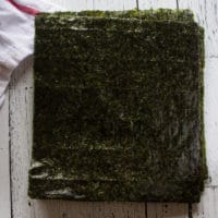 A stack of seaweed sheets to roll the sushi burrito