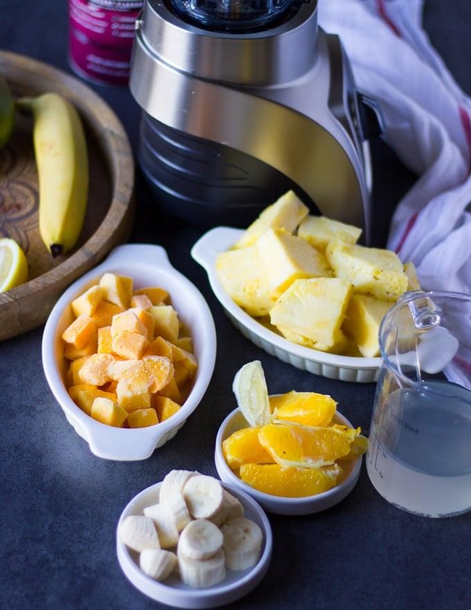 ingredients for the mango banana or pineapple banana layer : frozen mango chunks, pineapple chunks, banana, peeled orange segments and coconut water.