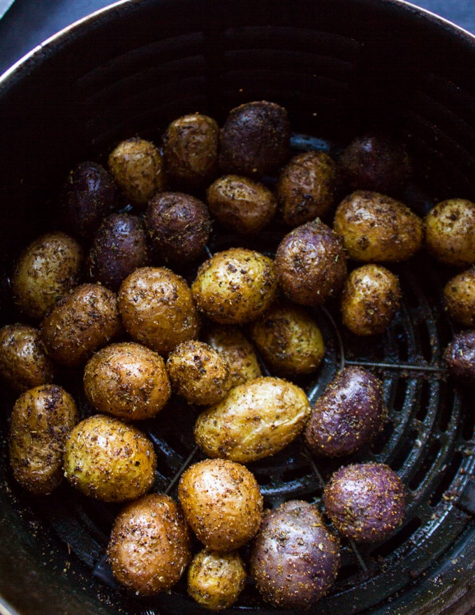 Crispy air fryer potatoes ready and cooked perfectly in the air fryer basket
