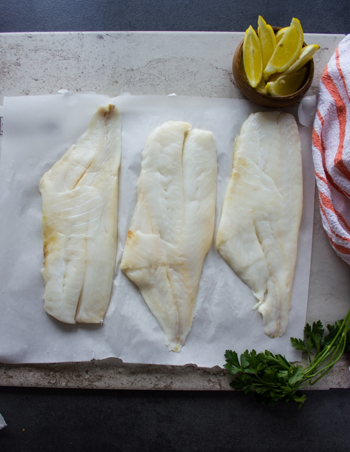 Orange roughy fillets on a white marble