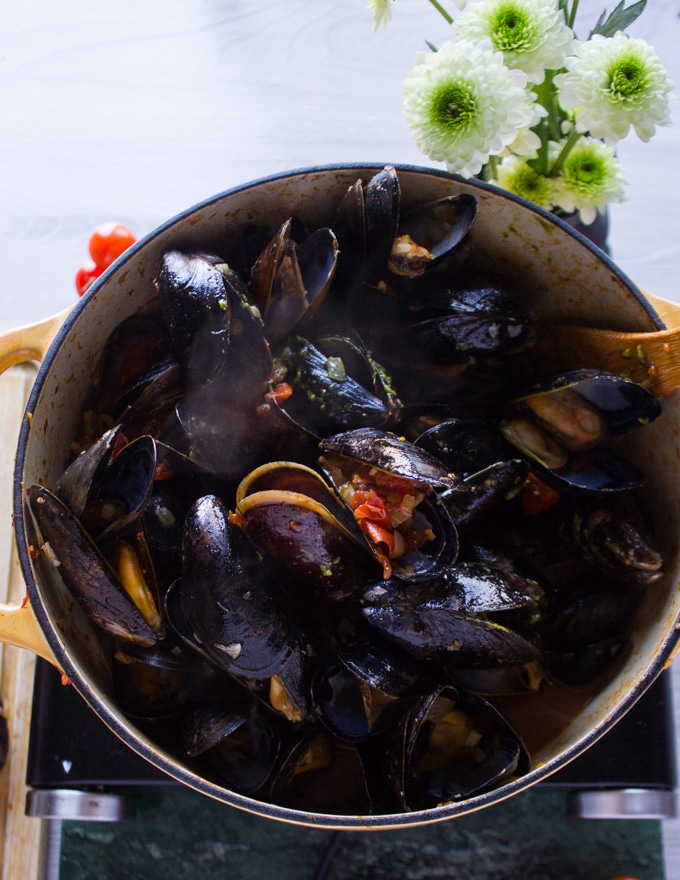 Mussels added into the pot with marinara sauce