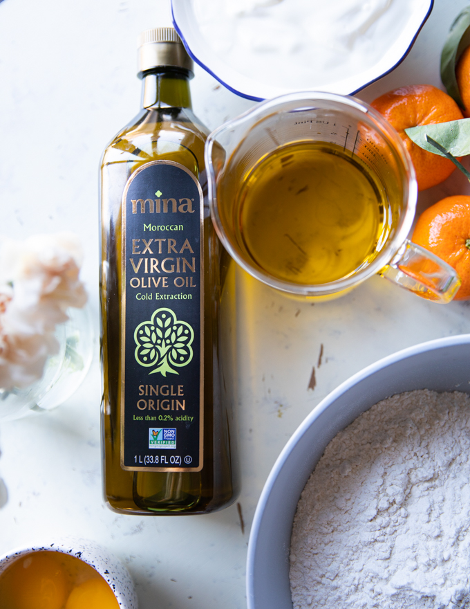 A cup pf pure extra virgin olive oil in a glass cup showing the clarity and purity of the oil