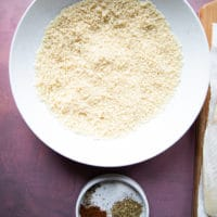 Panko bread crumbs in a bowl and another small bowl of spices ready to flavor the breadcrumbs