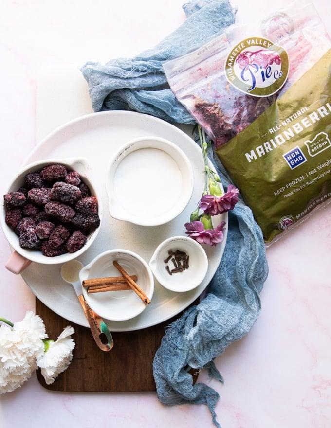 ingredients to make the marion blackberry jam including blackberries, sugar, cinnamon, cloves and gelatin