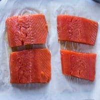 sockeye salmon fillets on a parchment paper