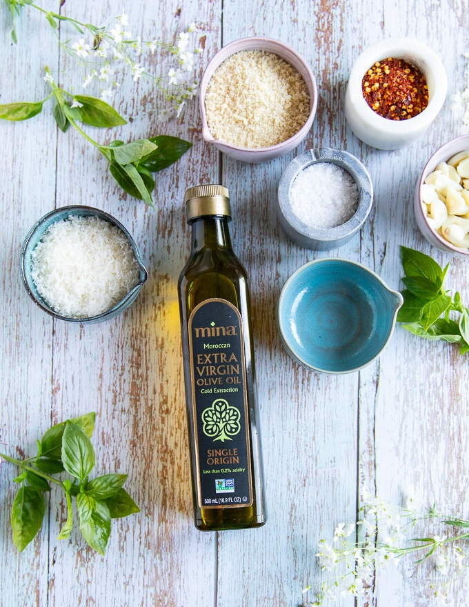 Ingredients for the olive oil pasta sauce including Moroccan olive oil, garlic, parmesan cheese, salt, chilli flakes, fresh basil