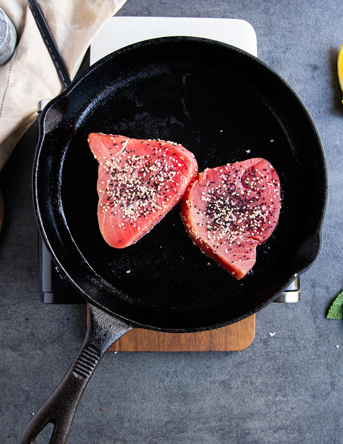 the tuna steaks in a heavy duty cast iton over high heat for seared tuna recipe