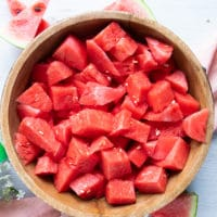 watermelon cut up into 1 inch cubes in a large bowl
