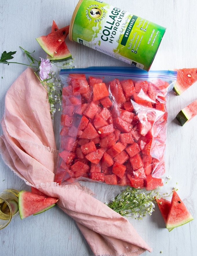 a large freezer bag filled with the watermelon and sealed is ready for the freezer